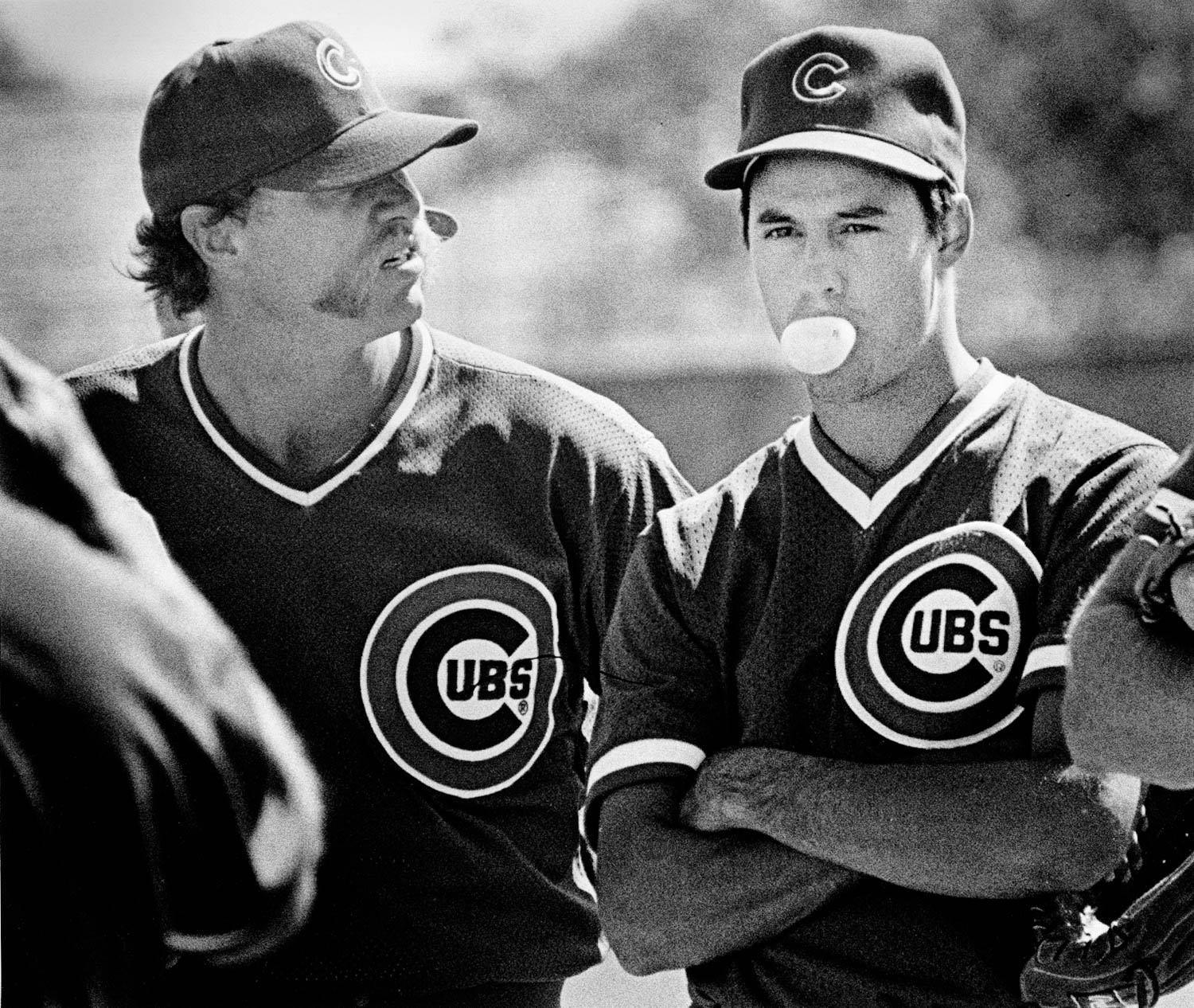 Future Hall of Famers - Veteran Cubs pitcher Goose Gossage reacts quizzically to third-year starter Greg Maddux blowing a bubble during a spring training workout in Mesa, Az. Both pitchers have since been inducted into the Baseball Hall of Fame. Gossage was inducted in 2008 and Maddux in 2014. (Todd Mizener)