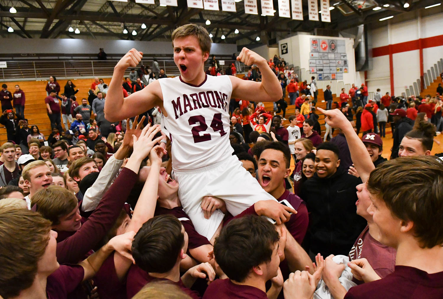 Moline fans lift Ethan Lapaczonek (24) on their shoulders after the Maroons defeated Rock Island, 55-43, in the Class 4A Pekin Sectional Tuesday, March 6, 2018, at Dawdy Hawkins Gym. (Todd Mizener - Dispatch/Argus)