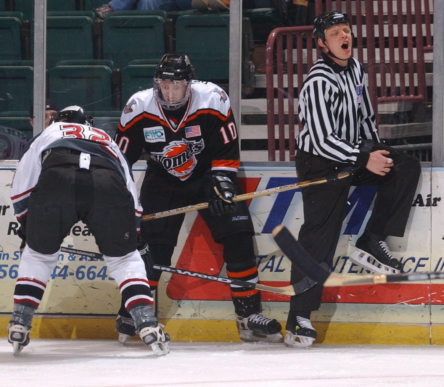 UHL linesman John Morrison takes a stick to the groin from Fort Wayne Komet winger David-Alexandre Beauregard while tied up with Quad City Mallard defenseman Tom Menicci. (Todd Mizener - Dispatch/Argus)