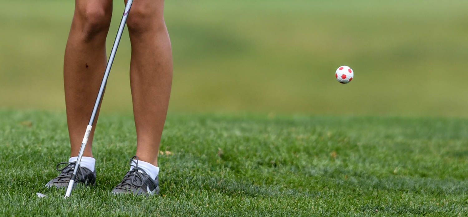 Moline's Sam Cramer chips on to the 3rd green during the IHSA Class 2A girls golf regional Wednesday, Oct. 4, 2017, at Oakwood Country Club in Coal Valley. Cramer uses a soccer themed golf ball as an homage to her other favorite sport. (Todd Mizener - Dispatch/Argus)